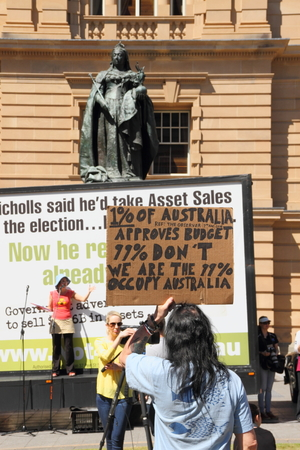 BRISBANE, AUSTRALIA - AUGUST 31: Unidentified protester with pro occupy movement policy sign at March Australia Rally August 31, 2014 in Brisbane, Australia