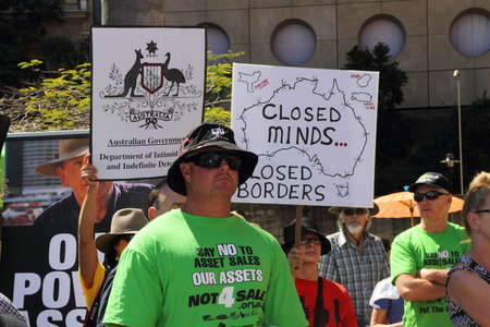 nazi flag: BRISBANE, AUSTRALIA - AUGUST 31: Unidentified protesters with anti LNP government signs at March Australia Rally August 31, 2014 in Brisbane, Australia Editorial