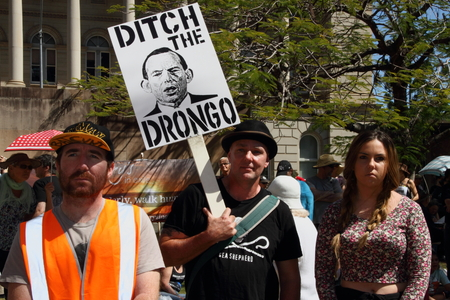 BRISBANE, AUSTRALIA - AUGUST 31: Unidentified protesters with anti primeminister Abbott sign at March Australia Rally August 31, 2014 in Brisbane, Australia Editorial