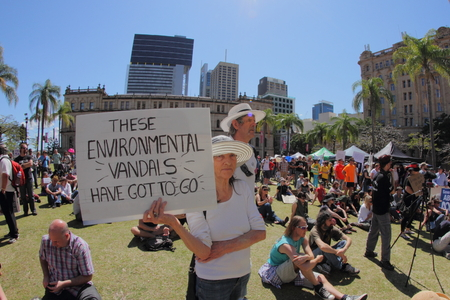 abbott: BRISBANE, AUSTRALIA - AUGUST 31: Unidentified protester with anti government environment policy signs at March Australia Rally August 31, 2014 in Brisbane, Australia