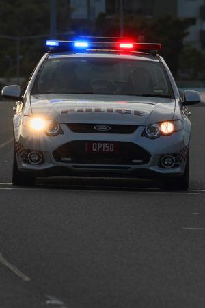 patrolling: BRISBANE, AUSTRALIA - SEPTEMBER 07 : Police patrolling closed road before Bridge to Brisbane charity fun run on September 07, 2014 in Brisbane, Australia