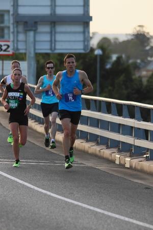 BRISBANE, AUSTRALIA - SEPTEMBER 07 : Unidentified runners  participating in the Bridge to Brisbane charity fun run on September 07, 2014 in Brisbane, Australia