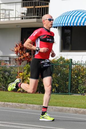 ルーク: ムールーラバ, オーストラリア - 9 月 14 日: ・ ウィットモアのルーク プロで、「アイアンマン 70.3」トライアスロン 2014 年 9 月 14 日ムールーラバ, オーストラリアの