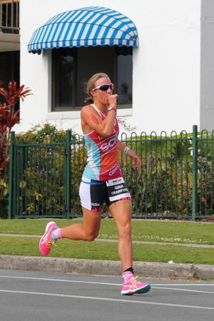 MOOLOOLABA, AUSTRALIA - SEPTEMBER 14 : Pro Gina Crawford 3rd in the Ironman 70.3 triathlon on September 14, 2014 in Mooloolaba, Australia