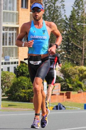 MOOLOOLABA, AUSTRALIA - SEPTEMBER 14 : Pro Tim Green in the Ironman 70.3 triathlon on September 14, 2014 in Mooloolaba, Australia