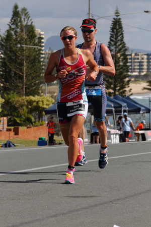MOOLOOLABA, AUSTRALIA - SEPTEMBER 14 : Pro Gina Crawford 3rd placer and Travis Shields in the Ironman 70.3 triathlon on September 14, 2014 in Mooloolaba, Australia