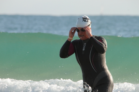 MOOLOOLABA, AUSTRALIA - SEPTEMBER 14 : Unidentified competitor in the Ironman 70.3 triathlon on September 14, 2014 in Mooloolaba, Australia