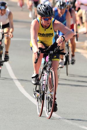 MOOLOOLABA, AUSTRALIA - SEPTEMBER 14 : Unidentified participant in cycle leg of sunshine coast triathlon on September 14, 2014 in Mooloolaba, Australia
