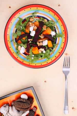 chickpea: roasted beetroot and pumpkin goats cheese salad with microgreens Stock Photo
