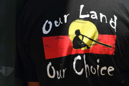 BRISBANE, AUSTRALIA - NOVEMBER 14 : Aborignal self governing tshirt at g20 aboriginal protest on November 14, 2014 in Brisbane, Australia Editorial