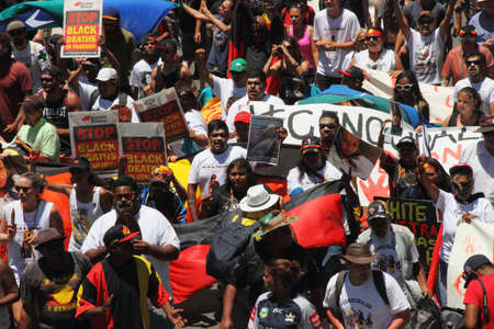 abbott: BRISBANE, AUSTRALIA - NOVEMBER 14: Aboriginals street marching protesting deaths in custody at g20 on November 14, 2014 in Brisbane, Australia