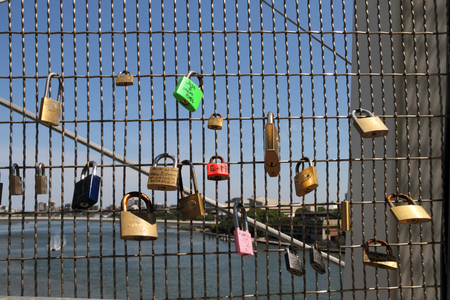 lockdown: BRISBANE, AUSTRALIA - NOVEMBER 14: Love locks on kurilpa bridge during g20 city security lock down on November 14, 2014 in Brisbane, Australia