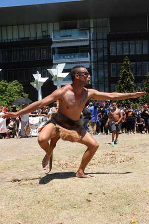 abbott: BRISBANE, AUSTRALIA - NOVEMBER 14: Aboriginal tribal kangaroo dancer at deaths in custody g20 protest on November 14, 2014 in Brisbane, Australia Editorial