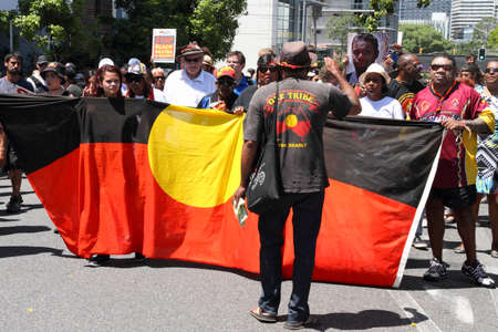g20: BRISBANE, AUSTRALIA - NOVEMBER 14: Aboriginals street marching protesting deaths in custody at g20 on November 14, 2014 in Brisbane, Australia