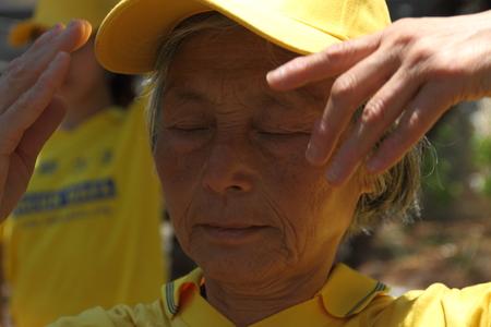 persecution: BRISBANE, AUSTRALIA - NOVEMBER 15: Unidentified Falun Gong protesting Chinese persecution and organ trade at g20 rally on November 15, 2014 in Brisbane, Australia