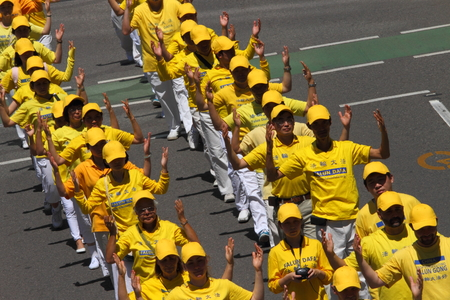 abbott: BRISBANE, AUSTRALIA - NOVEMBER 15: Falun Gong protesting Chinese persecution and organ trade at g20 rally on November 15, 2014 in Brisbane, Australia