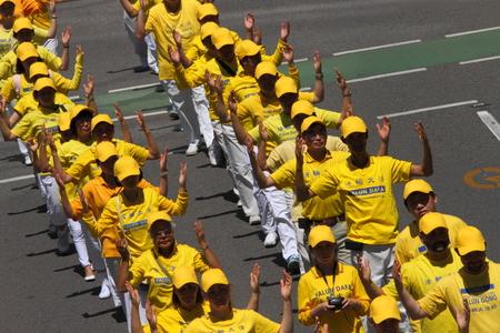 persecution: BRISBANE, AUSTRALIA - NOVEMBER 15: Falun Gong protesting Chinese persecution and organ trade at g20 rally on November 15, 2014 in Brisbane, Australia