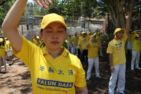 abbott: BRISBANE, AUSTRALIA - NOVEMBER 15: Unidentified Falun Gong protesting Chinese persecution and organ trade at g20 rally on November 15, 2014 in Brisbane, Australia