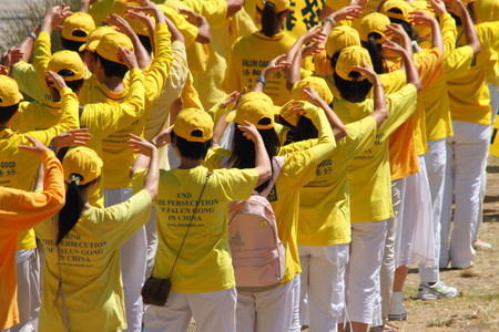 BRISBANE, AUSTRALIA - NOVEMBER 15: Falun Gong protesting Chinese persecution and organ trade at g20 rally on November 15, 2014 in Brisbane, Australia