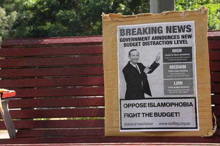backlash: BRISBANE, AUSTRALIA - NOVEMBER 15: Anti liberal government rhetoric sign at g20 protest on November 15, 2014 in Brisbane, Australia