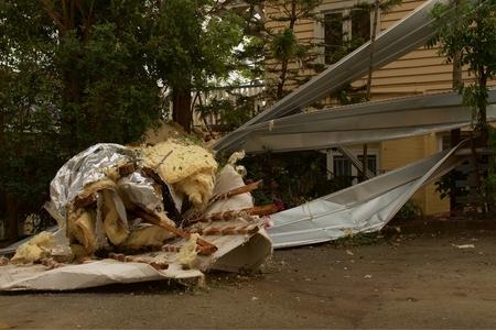 declared: BRISBANE, AUSTRALIA - NOVEMBER 28 : Roof littering tree from super cell hail storm area declared disaster on November 28, 2014 in Brisbane, Australia