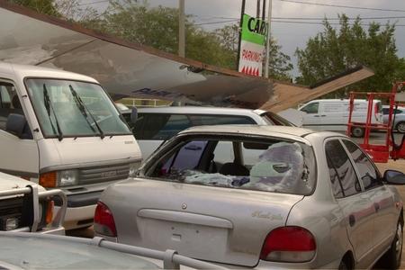 cell damage: BRISBANE, AUSTRALIA - NOVEMBER 28 : Damage to car yard from super cell hail storm area declared disaster on November 28, 2014 in Brisbane, Australia Editorial