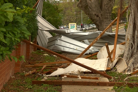 declared: BRISBANE, AUSTRALIA - NOVEMBER 28 : Roof on footpath from super cell hail storm area declared disaster on November 28, 2014 in Brisbane, Australia Editorial