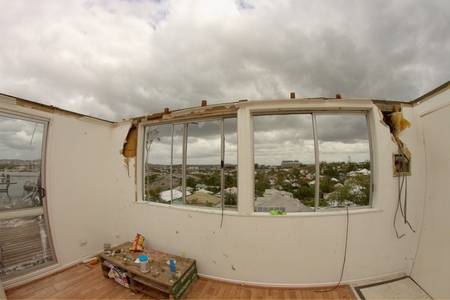 declared: BRISBANE, AUSTRALIA - NOVEMBER 28 : Roof blown off unit from super cell hail storm area declared disaster on November 28, 2014 in Brisbane, Australia Editorial