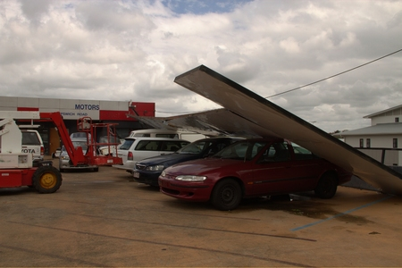 declared: BRISBANE, AUSTRALIA - NOVEMBER 28 : Damage to car yard from super cell hail storm area declared disaster on November 28, 2014 in Brisbane, Australia Editorial