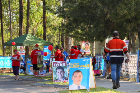 state election: MORAYFIELD, AUSTRALIA - JANUARY 31: Queensland State Election undentified party volunteers haning out how to vote cards on January 31, 2015 in Morayfield, Australia