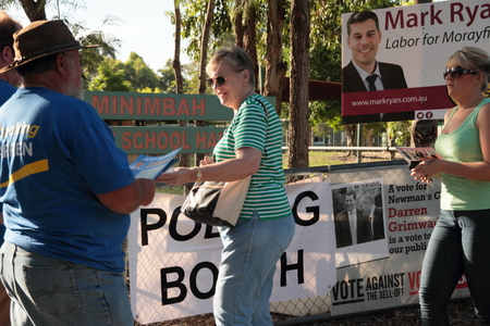 MORAYFIELD, AUSTRALIA - JANUARY 31: Queensland State Election undentified party volunteers haning out how to vote cards on January 31, 2015 in Morayfield, Australia