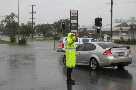 damage control: MORAYFIELD, AUSTRALIA - FEBRUARY 21: Police controlling flooded roadways caused by cyclone Marcia  on Feburay 21, 2015 in Morayfield, Australia