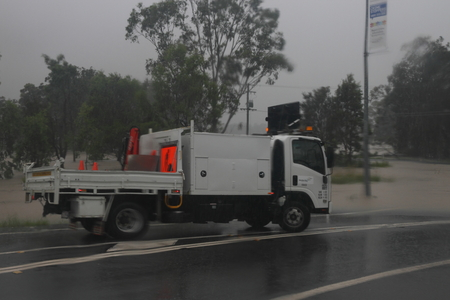 MORAYFIELD, AUSTRALIA - FEBRUARY 21: Council truck parked to close flooded road caused by Cyclone Marcia on Feburay 21, 2015 in Morayfield, Australia