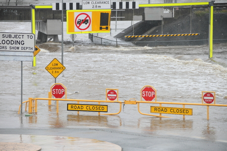 causing: MORAYFIELD, AUSTRALIA - FEBRUARY 20: Cyclone Marcia causing flash flooding across roads on Feburay 20, 2015 in Morayfield, Australia
