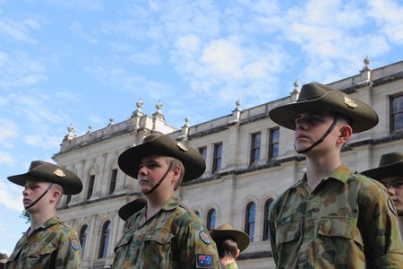 unknown age: BRISBANE, AUSTRALIA - APRIL 25 :Army Cadets at attention before march during Anzac day centenary commemorations April 25, 2015 in Brisbane, Australia