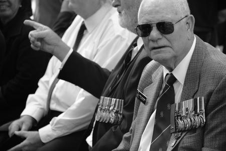 spectating: BRISBANE, AUSTRALIA - APRIL 25 : Veterans spectating before march commencement of Anzac day centenary commemorations April 25, 2015 in Brisbane, Australia