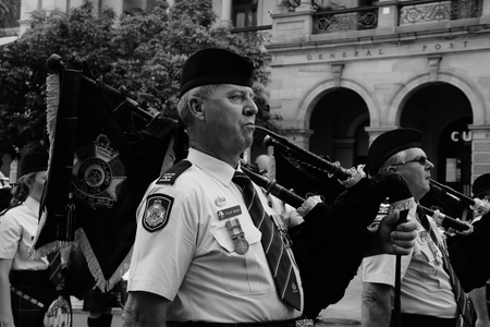 march band: BRISBANE, AUSTRALIA - APRIL 25 : Police band playing on march during Anzac day centenary commemorations April 25, 2015 in Brisbane, Australia Editorial