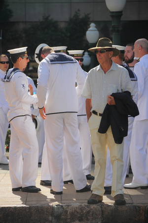 spectator: BRISBANE, AUSTRALIA - APRIL 25 Spectator with Sailors before march during Anzac day centenary commemorations April 25, 2015 in Brisbane, Australia