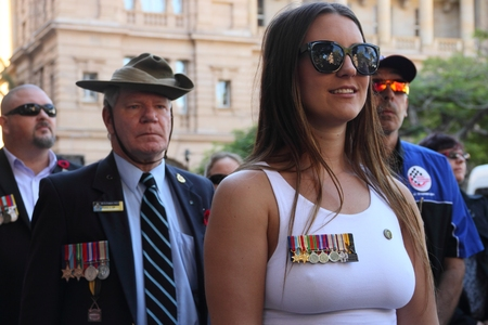relative: BRISBANE, AUSTRALIA - APRIL 25 : Relative marching in place of veteran during Anzac day centenary commemorations April 25, 2015 in Brisbane, Australia