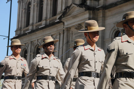 the flanders: BRISBANE, AUSTRALIA - APRIL 25 : Soldiers march along the route during Anzac day centenary commemorations April 25, 2015 in Brisbane, Australia
