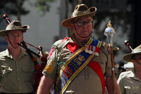 march band: BRISBANE, AUSTRALIA - APRIL 25 : Military band performing along march during Anzac day centenary commemorations April 25, 2015 in Brisbane, Australia