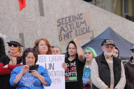 abbott: BRISBANE AUSTRALIA  JUNE 20 : Unidentified protesters take part in World Refugee Day Rally June 20 2015 in Brisbane Australia