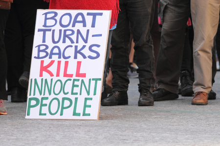 governement: BRISBANE AUSTRALIA  JUNE 20 : Anti governement boat turn back practice placard at World Refugee Day Rally June 20 2015 in Brisbane Australia Editorial