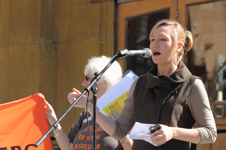 abbott: BRISBANE, AUSTRALIA - JUNE 20 :Greens Senator Larissa Waters speaking at World Refugee Rally June 20, 2015 in Brisbane, Australia Editorial