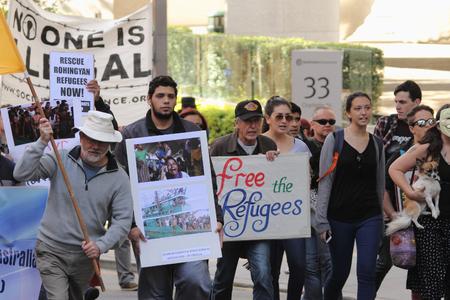 marchers: BRISBANE, AUSTRALIA - JUNE 20 :Street marchers during World Refugee Rally June 20, 2015 in Brisbane, Australia