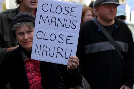 detention: BRISBANE, AUSTRALIA - JUNE 20: Street marcher with sign calling for closure of Nauru and Manus island detention center during World Refugee Rally June 20, 2015 in Brisbane, Australia Editorial