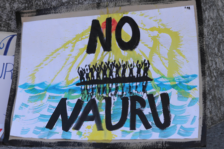 amnesty: BRISBANE, AUSTRALIA - JUNE 20 : Sign calling for closure of the Naura Island detention center at World Refugee Day Rally June 20, 2015 in Brisbane, Australia