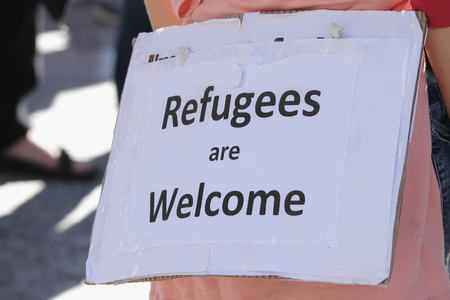 abbott: BRISBANE, AUSTRALIA - JUNE 20 : Sign suggesting ordinary Australians welcome refugess at World Refugee Day Rally June 20, 2015 in Brisbane, Australia Editorial