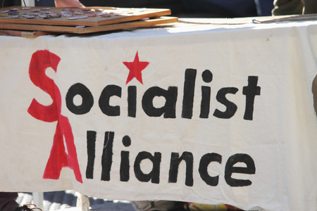 abbott: BRISBANE, AUSTRALIA - JUNE 20 : Socialist Party Political banner at World Refugee Day Rally June 20, 2015 in Brisbane, Australia Editorial