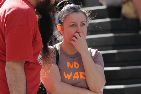 war refugee: BRISBANE, AUSTRALIA - JUNE 20: Unidentified rally goer with no war shirt at World Refugee Day Rally June 20, 2015 in Brisbane, Australia